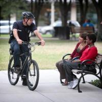 Bicycle Officer Interacting With Citizens