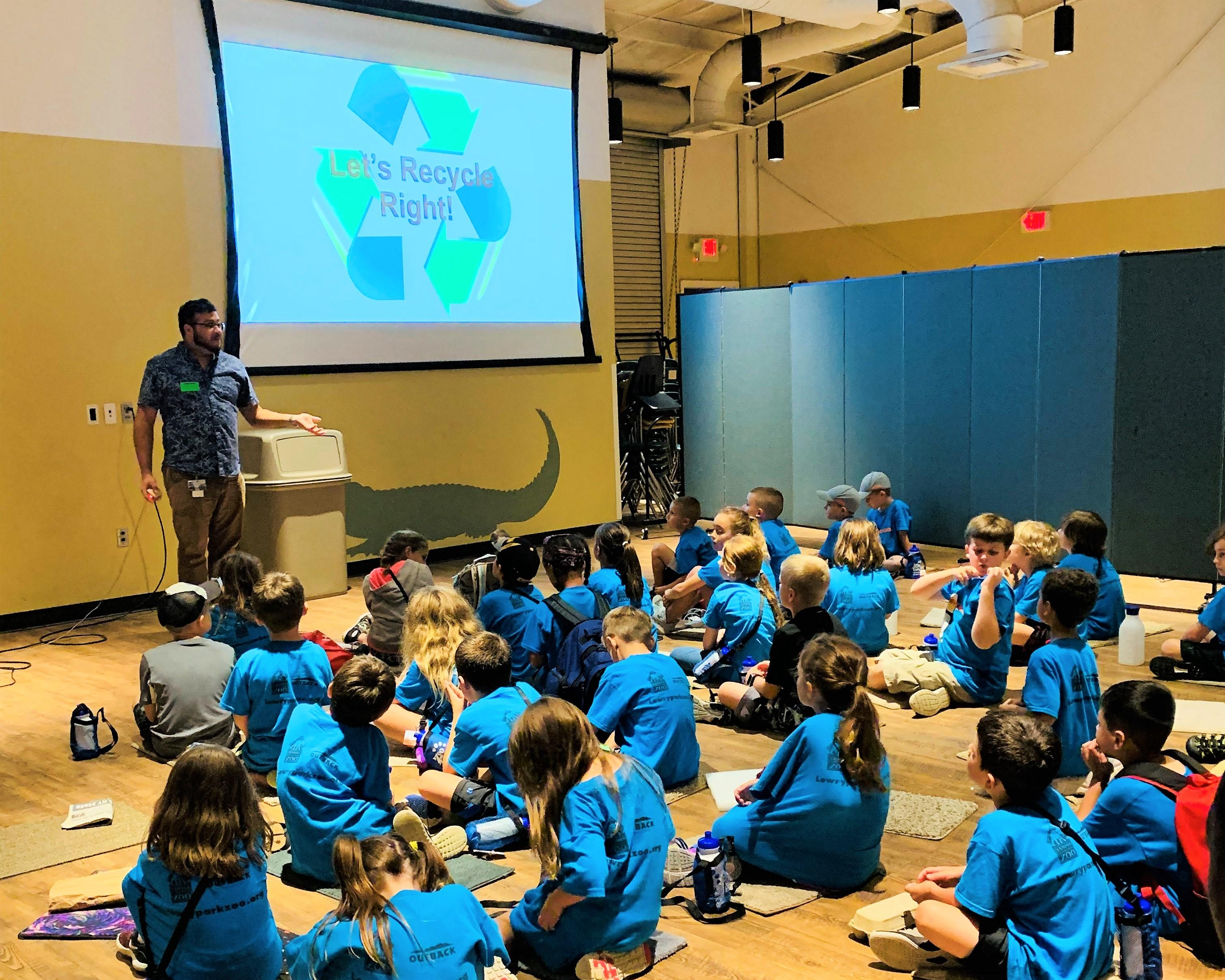 Recycling Specialist at Zoo Tampa presentation with kids