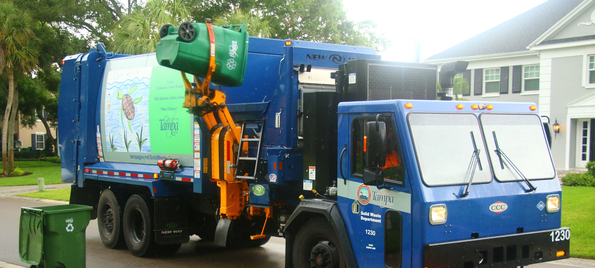 Recycling Truck servicing recycling cart
