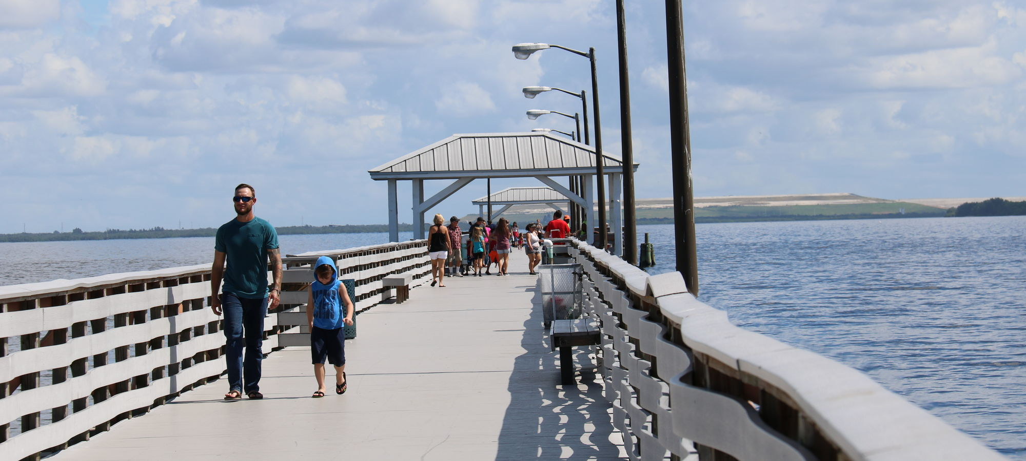People walking on pier