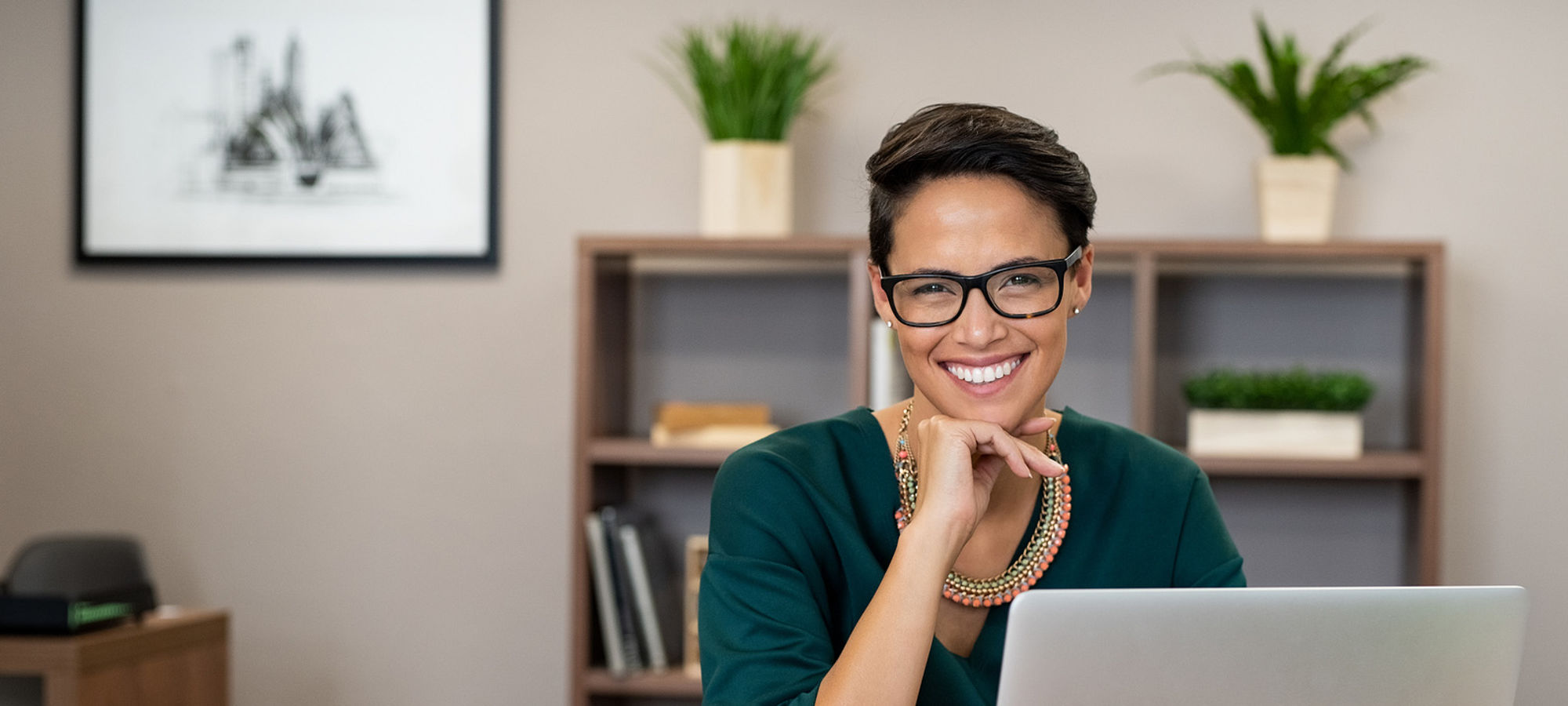 Smiling woman sitting at computer