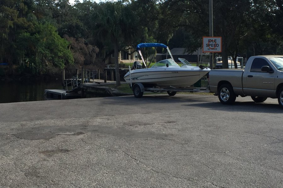 View of boat on trailer at boat ramp