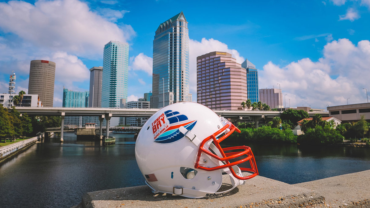 Super bowl helmet in front of downtown city skyline