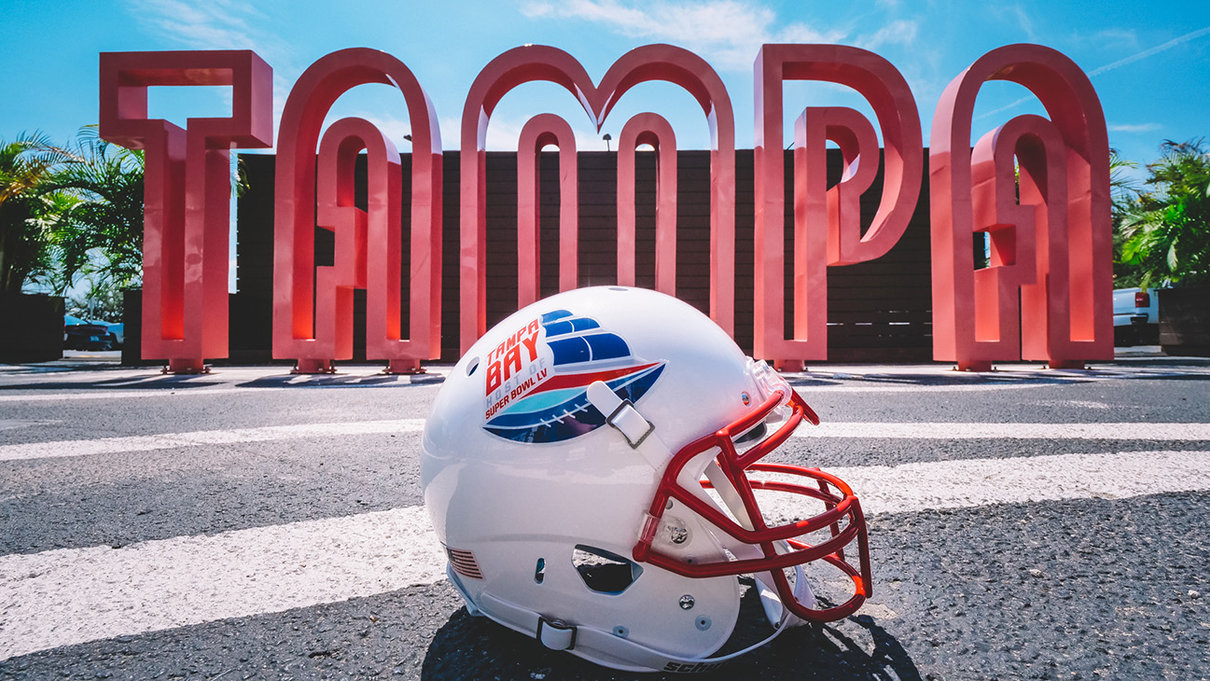 Super bowl helmet in front of Tampa sculpture